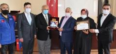 Deniz Feneri Ankara Şube'den Şehit Ailelerine Plaket Takdimi